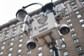 New York City, USA - January 9, 2015: Surveillance Security camera system operated by the NYPD located high on a street light pole on 7th Avenue between 32nd and 33rd Street in Manhattan, New York City.